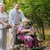 Grandmother as a flower girl in this a fall garden wedding with a brunch reception