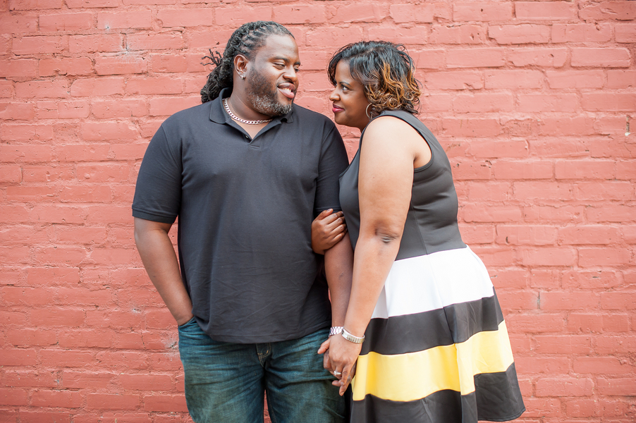 Urban Engagement Shoot In Small Downtown featuring a stunning curvy bride to be