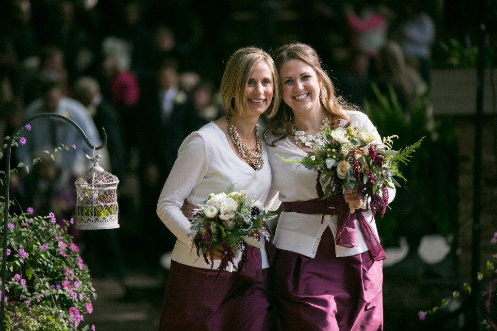 Bridesmaids wearing cardigans in this fall garden wedding with a brunch reception